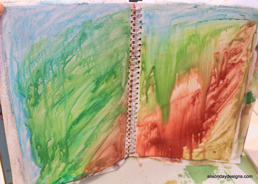 art journal page spritzed with water and running