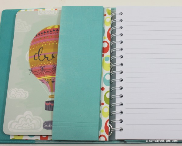 Planner with paper pocket for additional notebook